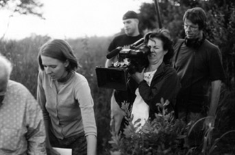 Director Katrina Browne (in front), Director of Photography Liz Dory, and other members of the production crew filming in Bristol, R.I.